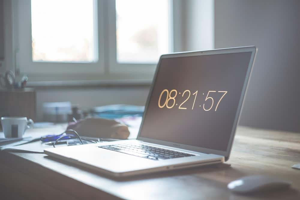 laptop image with clock on screen, media